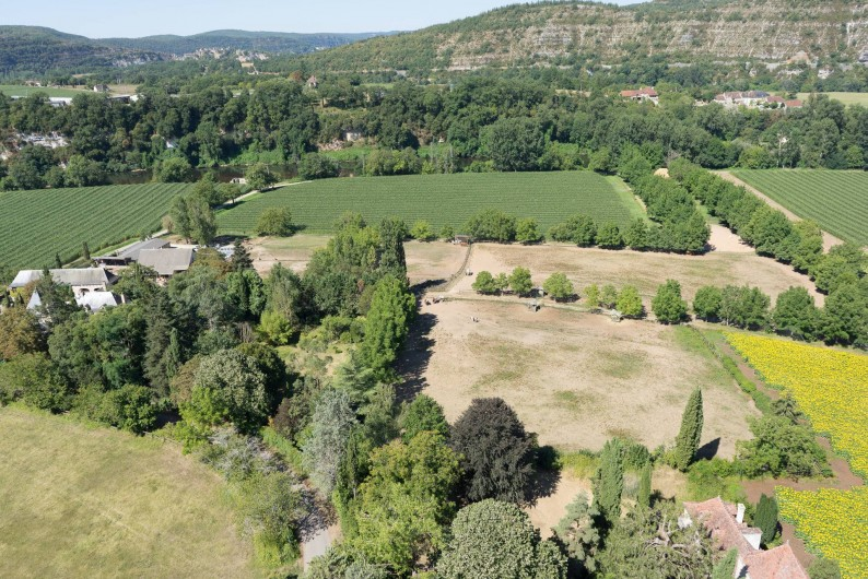 Location de vacances - Maison - Villa à Cajarc - vue au loin et à proximité un petit bout de la rivière Lot