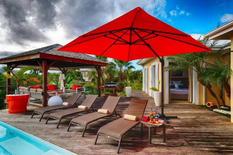 Location de vacances - Villa à Sainte-Anne - vue terrasse et carbet pour l'apéro