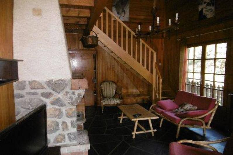 Location de vacances - Chalet à Alex - Séjour cheminée et coin détente