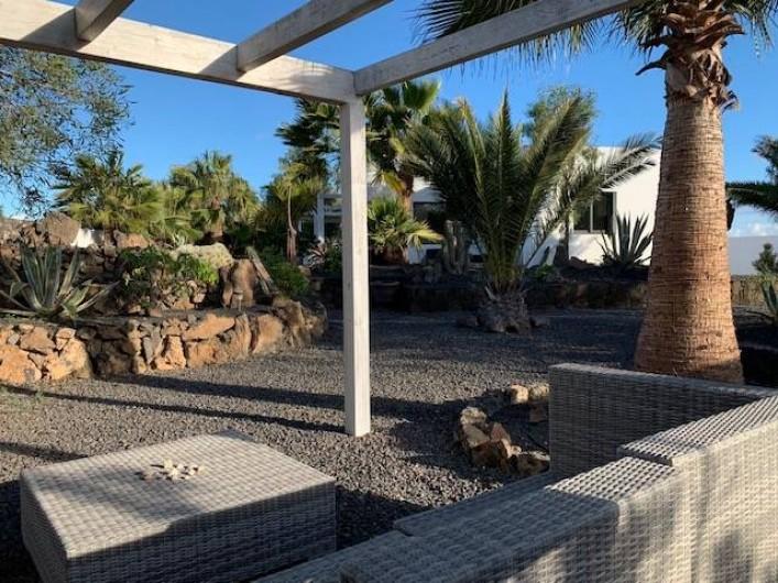 Location de vacances - Villa à Lajares - coin apero jardin