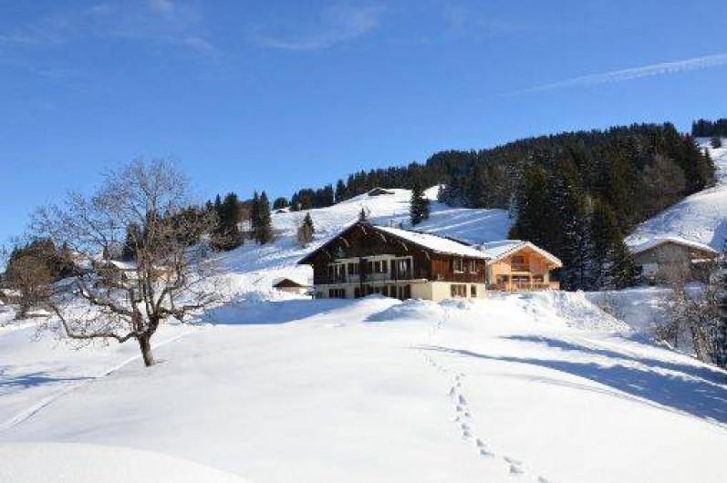 Location de vacances - Chalet à Crest-Voland - Vue depuis l'aval hiver