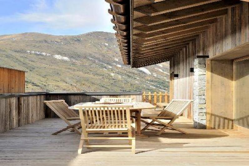Location de vacances - Chalet à Saint-Martin-de-Belleville - Terrasse avec vue sur la montagne.