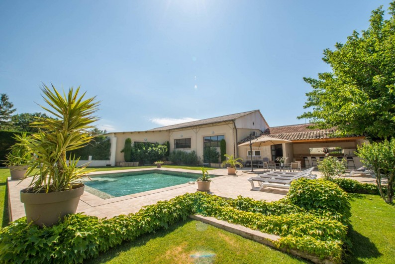 Location de vacances - Mas à Visan - piscine, jardin et plage de piscine
